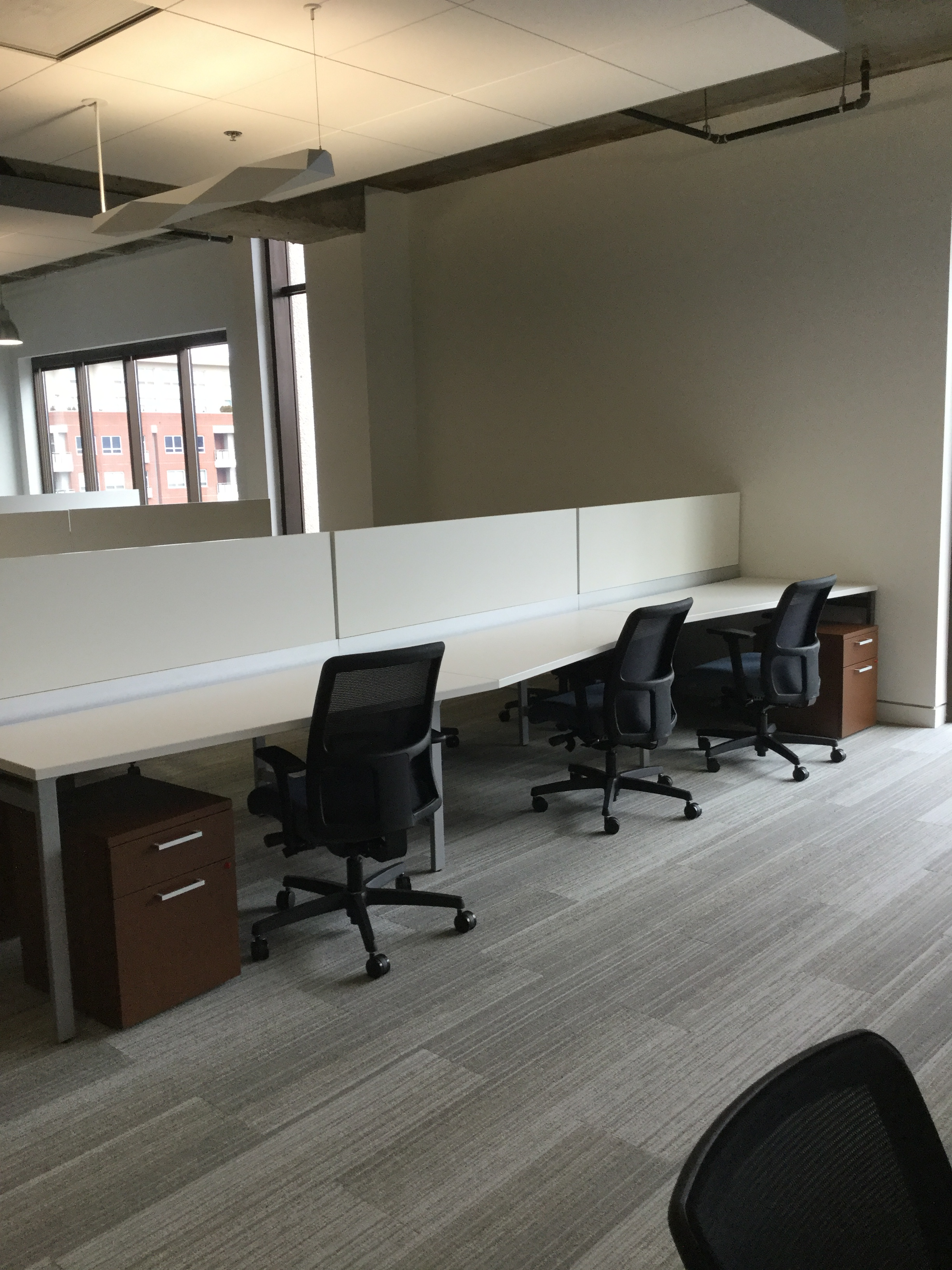 Interface Walk The Line Carpet Tile with First Office Staks Benching Desks and HON Ignition Task Chairs.