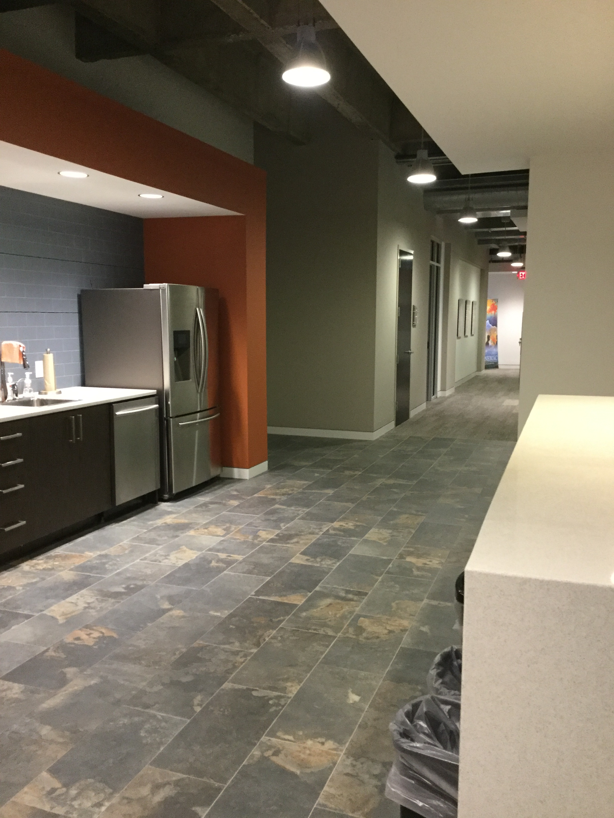 Breakroom with Crossville Tile and Interface Human Nature Carpet Tile.