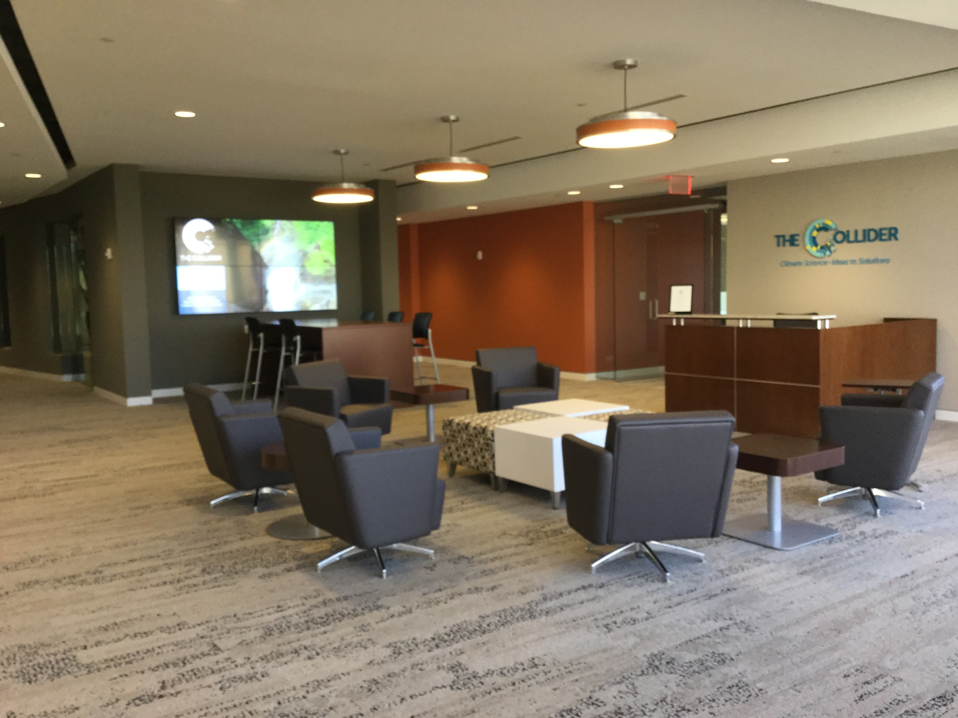 Lobby with Interface Human Nature Carpet Tile, National Fringe Lounge Seating and Ottomans and National Office furniture Staccato Occasional Tables.