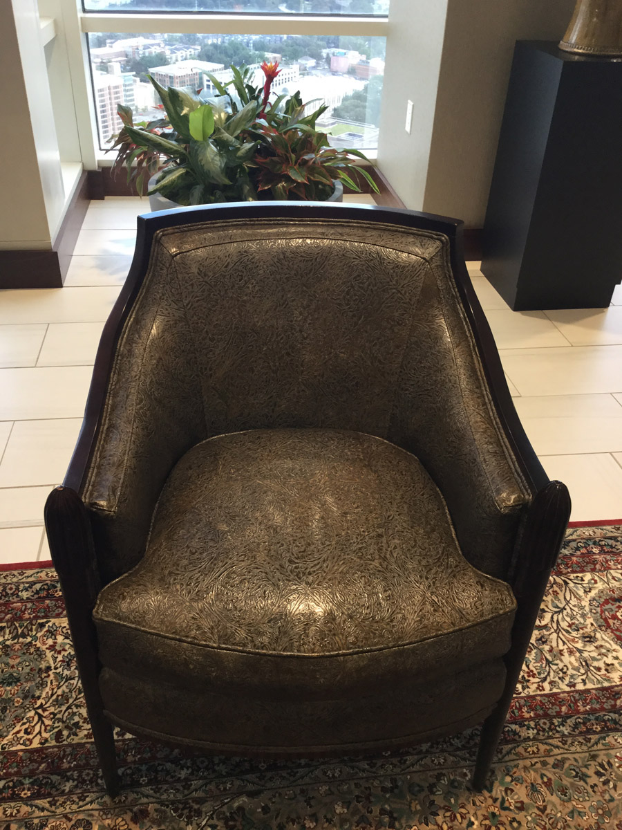 35th Floor Lobby existing lounge chairs reupholstered in Western Tool Cheyenne Rustic Embossed Hides from JP Leather Company in Hudson, NC and Crossville Moonstruck Porcelain Tile.