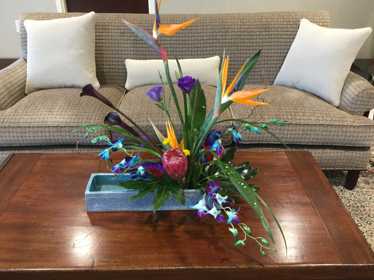 35th Floor Lobby existing sofa reupholstered in ArcCom Pala fabric and Ikebana Floral Arrangement designed by Choy's in Hendersonville, NC.