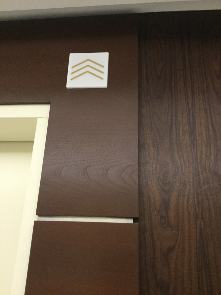 Elevator Lobby Detail with Custom details and SanFoot Mexican Rosewood Natural Wood Veneer Wallcovering.
