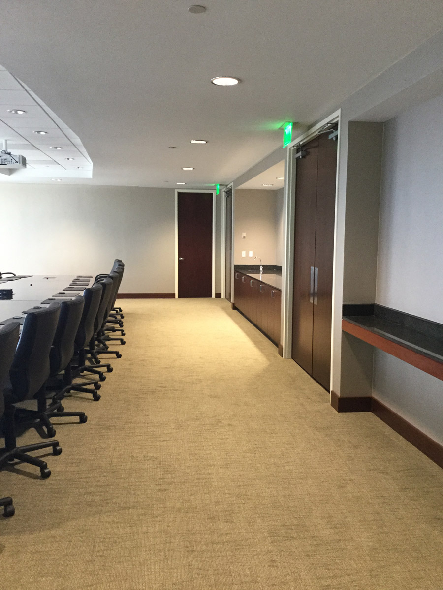 36th Floor Multipurpose room with Milliken Pen & Ink Flow Broadloom Carpet, Wolf Gordon Lillie Lil Type II Wallcovering and Armstrong Ultima Ceiling Tile Furniture is existing.