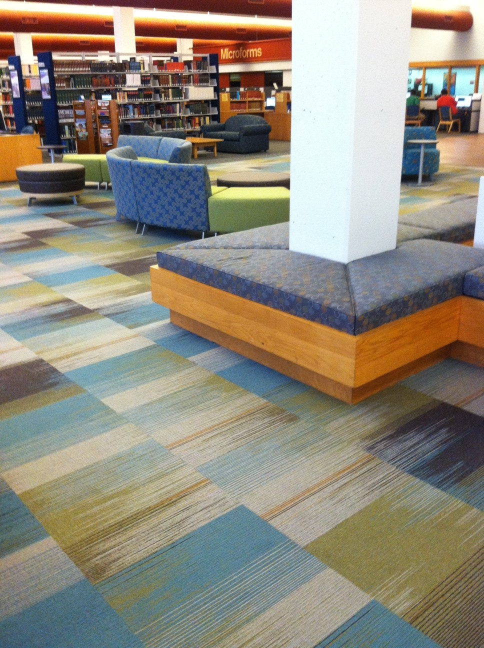 Tandus Change II Carpet Tile and Custom cushions in Momentum Amuse and Covercloth fabrics.