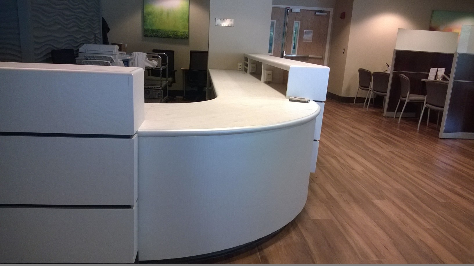 Install of DesignTex DiNoc product over existing reception desk. Specified by IIS, installed by Who Did That, Inc.