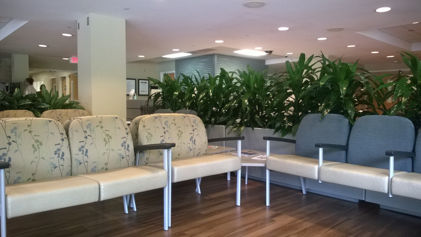 Lobby with Mohawk Group Select Step flooring, Stance Vista II with solid surface tops and Momentum Banter and CF Stinson Script fabrics. Fiberglass planters from Planter Designs, Inc. and Texture 3D wall panels.