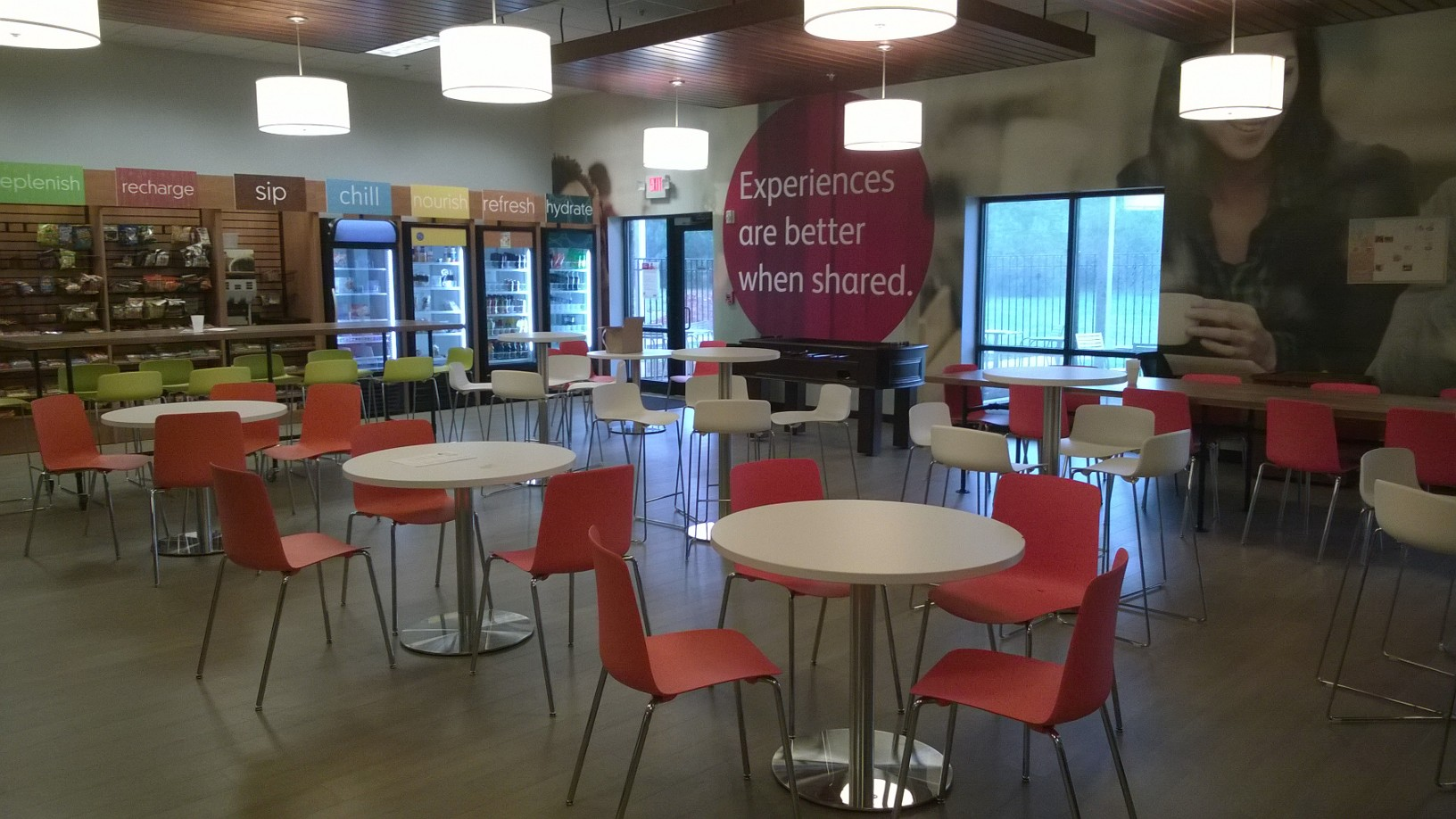 Breakroom with Emu Segno Stack Chair and Bistro Tables with ERG Corsa Café Table and Vesper Chair