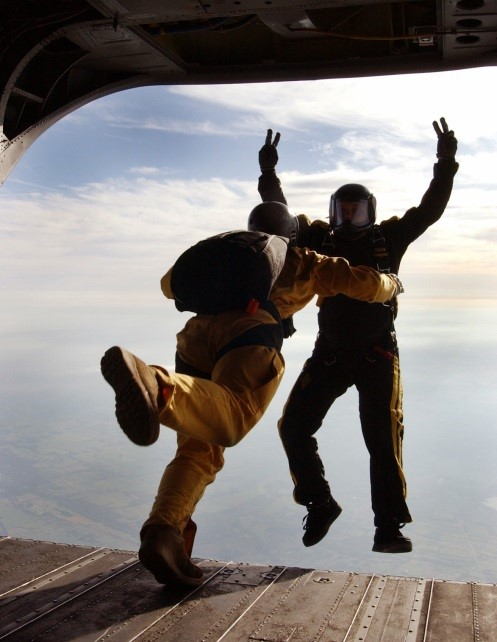 2 men jumping off a plane